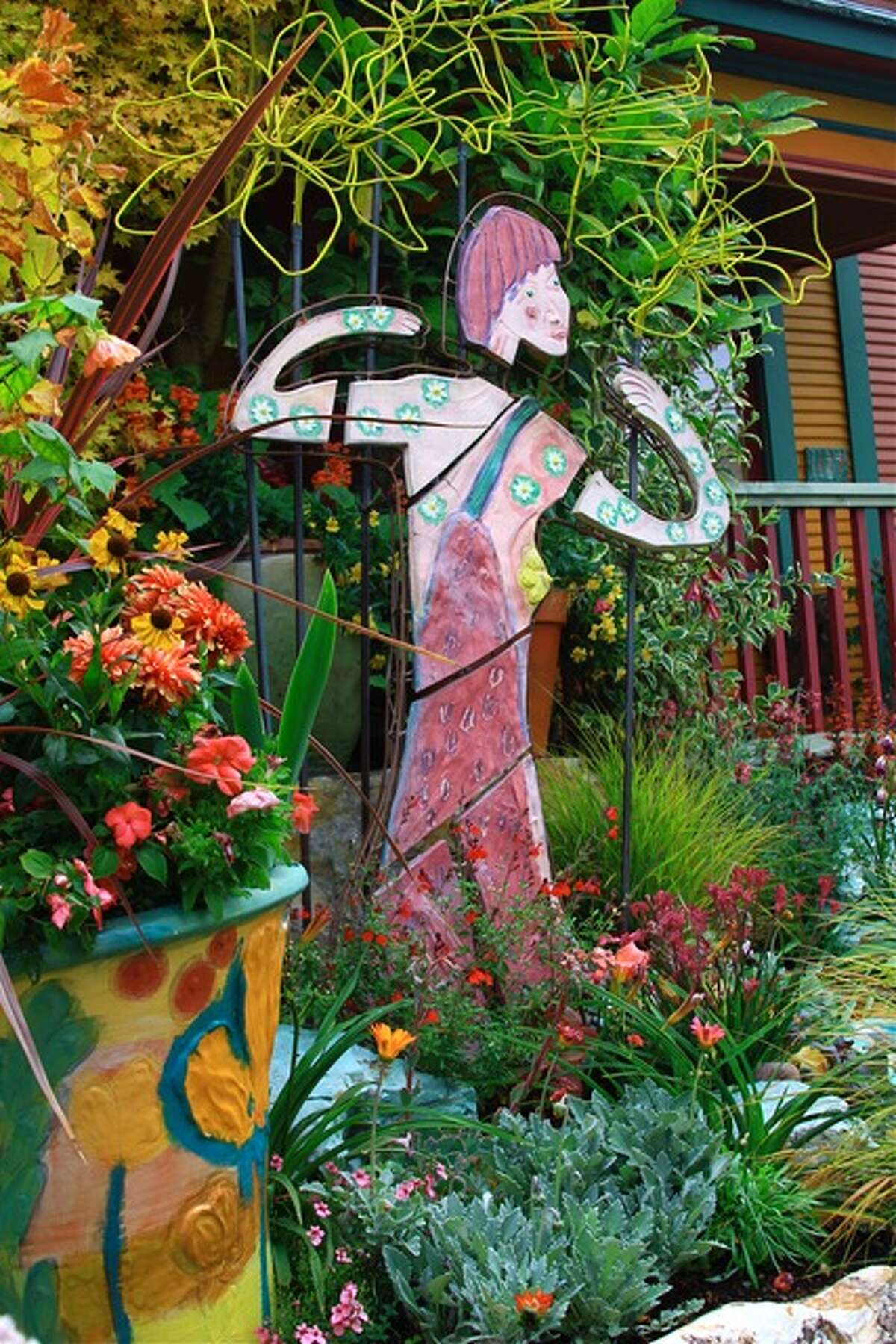 Ceramic and metal sculpture with harmonious plantings