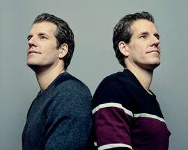 FILE -- Tyler, left, and Cameron Winklevoss, the longtime Bitcoin investors famed for their legal battles with Mark Zuckerberg over Facebook, in New York, Dec. 12, 2017. The twins are on a new Forbes list of cryptocurrency billionaires. (Vincent Tullo/The New York Times)