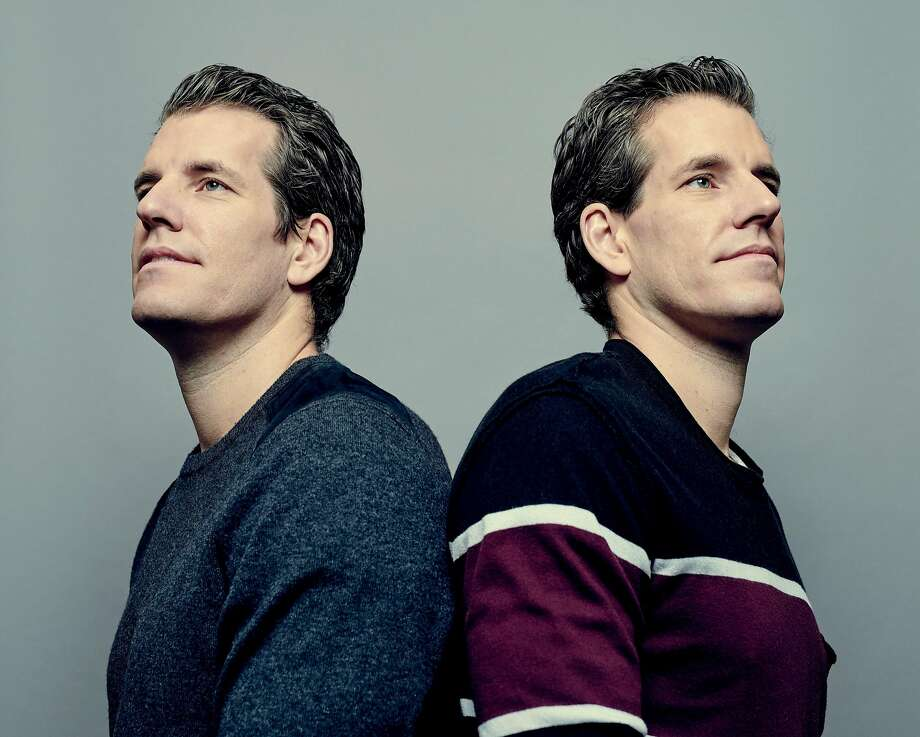 FILE -- Tyler, left, and Cameron Winklevoss, the longtime Bitcoin investors famed for their legal battles with Mark Zuckerberg over Facebook, in New York, Dec. 12, 2017. The twins are on a new Forbes list of cryptocurrency billionaires. (Vincent Tullo/The New York Times) Photo: VINCENT TULLO, NYT