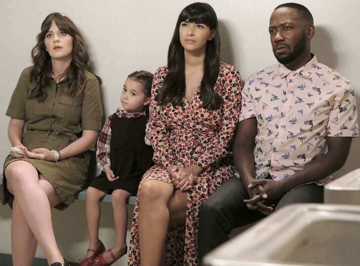 """Zooey Deschanel, guest star, Hannah Simone and Lamorne Morris in the """"About Three Years Later"""" season seven premiere episode of """"New Girl,"""" airing Tuesday on Fox."""