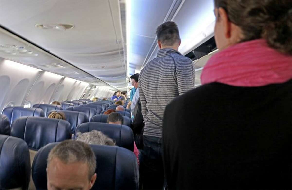 Flight attendants scan passengers for potential problems as they board. (Image: Jim Glab)