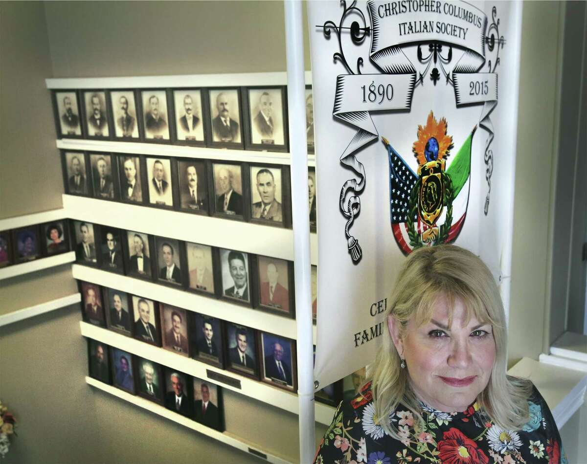Dawn Brooks Baamonde is one of the first women allowed to join the previously all-male Christopher Columbus Italian Society in San Antonio. On Monday, she stands in front of portraits of past presidents of the Catholic-affiliated organization. She was inducted the previous day.