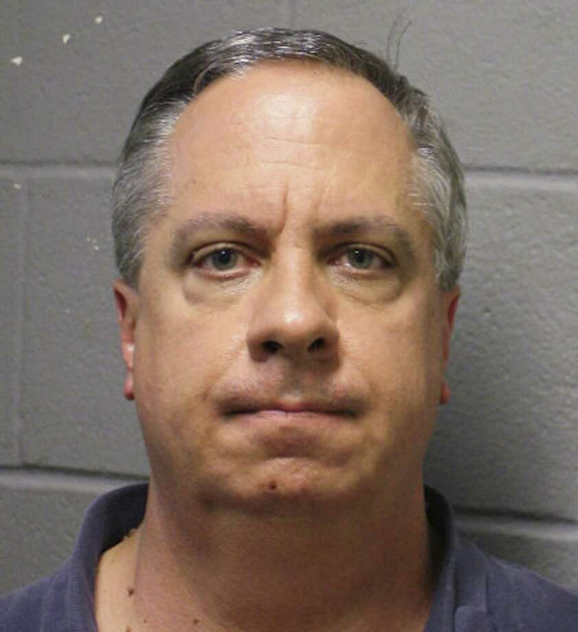 This undated photo provided by the Harris County District Attorney's Office in Houston shows Gregory Lueb. Lueb who is second in command of the Harris County Treasurer's Office is accused of stealing tens of thousands of dollars from a county credit union to pay a dominatrix who allegedly was blackmailing him. He was arrested Thursday, April 5, 2018, and charged with felony theft of up to $30,000. Photo: Associated Press / Harris County District Attorney's Office