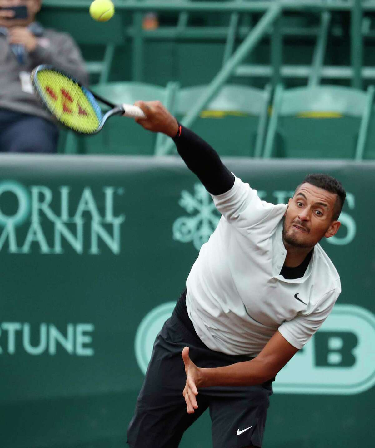 Nick Kyrgios serves in the first round of doubles with Matt Reid during the U.S. Men's Clay Court Championship at River Oaks Country Club, Monday, April 9, 2018, in Houston.