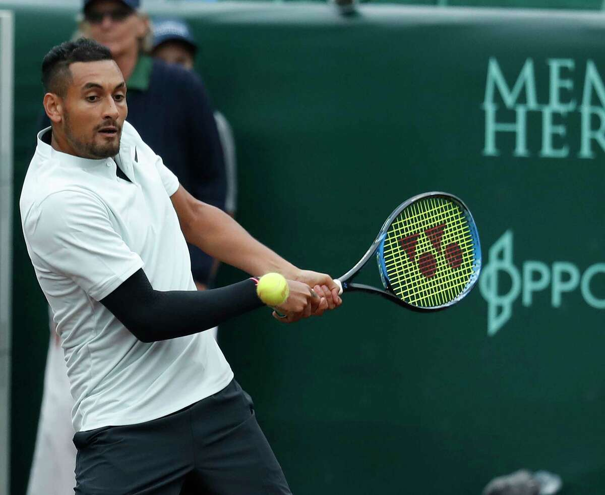 Nick Kyrgios competes in the first round of doubles with Matt Reid during the U.S. Men's Clay Court Championship at River Oaks Country Club, Monday, April 9, 2018, in Houston.