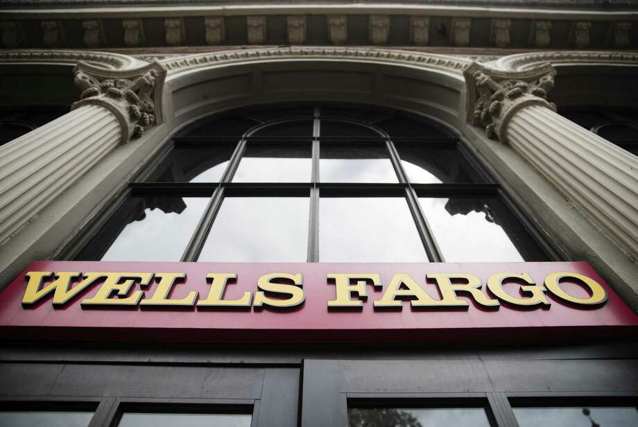 Wells Fargo also has been accused of forcing auto-loan customers into unneeded insurance policies and charging improper fees to some mortgage borrowers. Photo: Matt Rourke, STF / Associated Press / Copyright 2017 The Associated Press. All rights reserved.