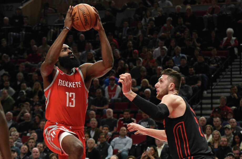 Houston Rockets guard James Harden drives to the basket on Portland Trail Blazers center Jusuf Nurkic during the first half of an NBA basketball game in Portland, Ore., Tuesday, March 20, 2018. (AP Photo/Steve Dykes) Photo: Steve Dykes / FR155163 AP