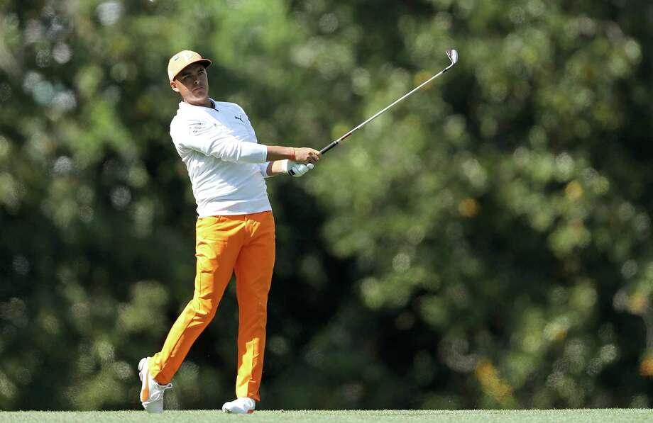 AUGUSTA, GA - APRIL 08:  Rickie Fowler of the United States plays his second shot on the fifth hole during the final round of the 2018 Masters Tournament at Augusta National Golf Club on April 8, 2018 in Augusta, Georgia.  (Photo by David Cannon/Getty Images) Photo: David Cannon / 2018 Getty Images