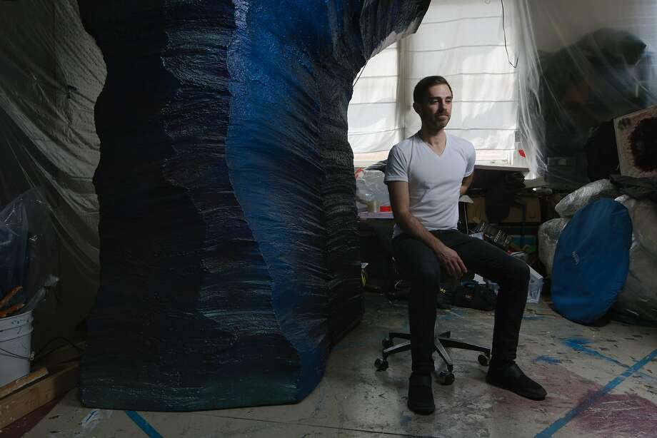 """Mike Rothfeld, next to his piece, """"It is tomorrow we bury here today,"""" which he made for the exhibition at the Contemporary Jewish Museum of San Francisco, """"Jewish Folktales Retold: Artist as Maddid,"""" in his studio in the Noonan Building at Pier 70 in San Francisco on March 30, 2018. Rothfeld studied photography as an undergraduate and pursued sculpture in graduate school at CCA. Photo: Peter Prato / Special To The Chronicle"""