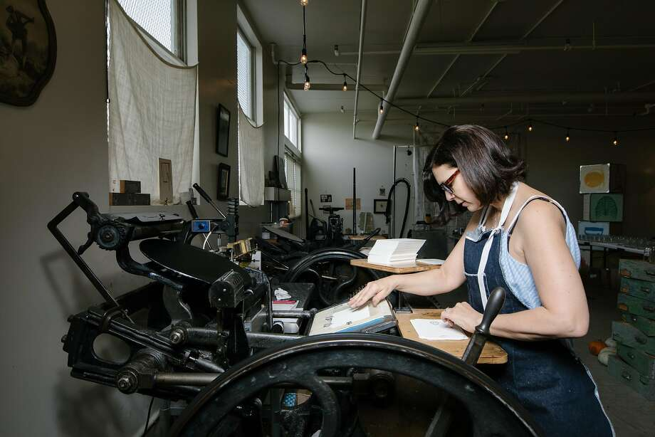 Kim Austin at her letterpress in her studio in The Noonan Building at Pier 70 in San Francisco on March 30, 2018. Photo: Peter Prato / Special To The Chronicle