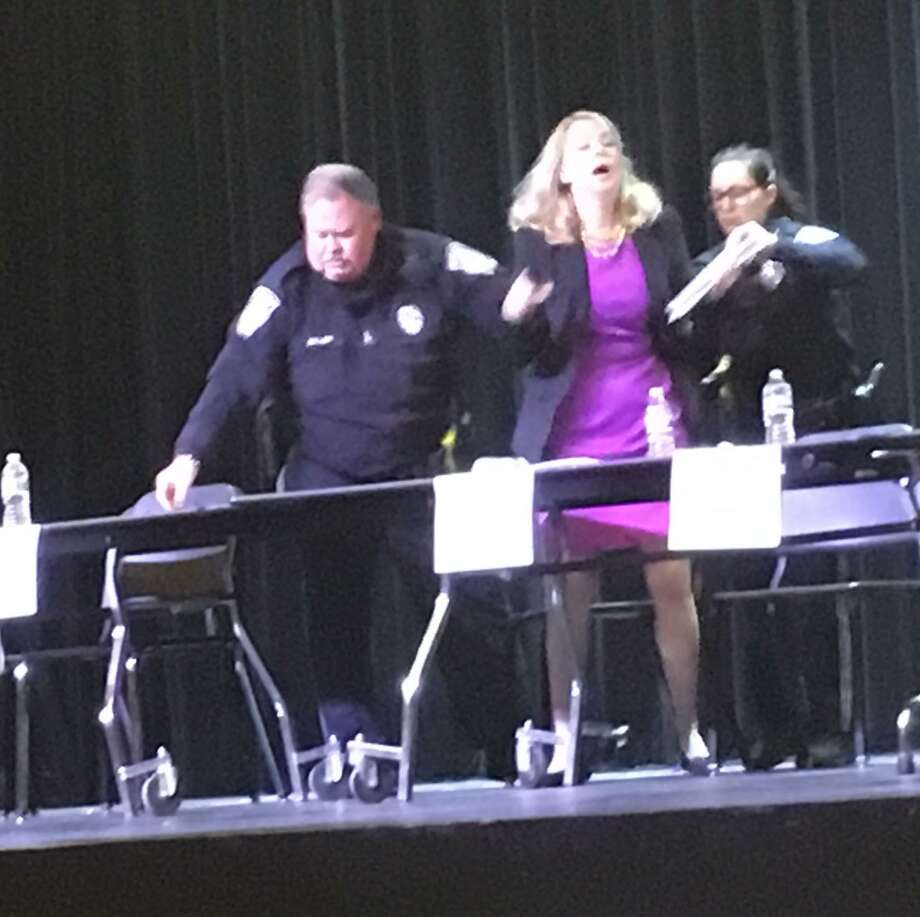 Lee Whitnum was dragged off the stage by cops at the Brookfield Town Democratic Forum. She hadn't been invited and refused to leave when asked. Photo: Kaitlyn Kresselt /