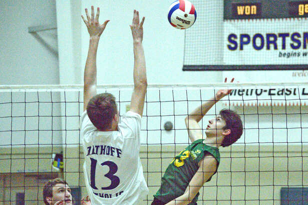 Metro-East Lutheran's Calvin Cunningham, right, goes up for a kill over Belleville Althoff's Jacob Gall during Monday's match at MELHS.