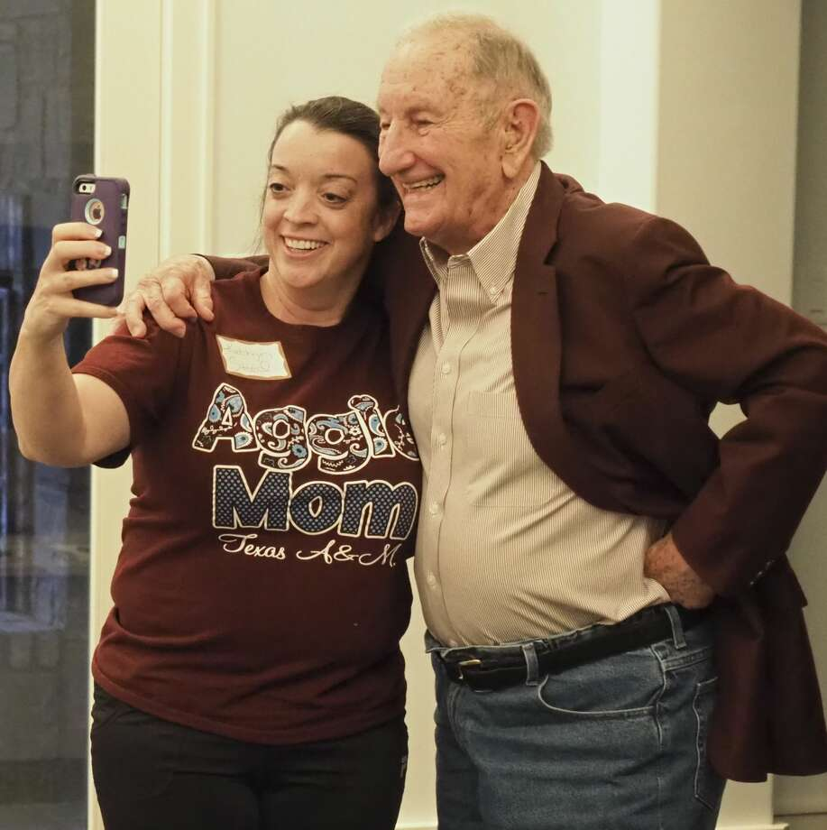 Kathryn Sneed takes a picture with Clayton (Claytie) Williams Jr 04/09/18 evening after an Aggie Moms meeting with a family history of the Williams family ties to Texas A&M. Tim Fischer/Reporter-Telegram Photo: Tim Fischer/Midland Reporter-Telegram