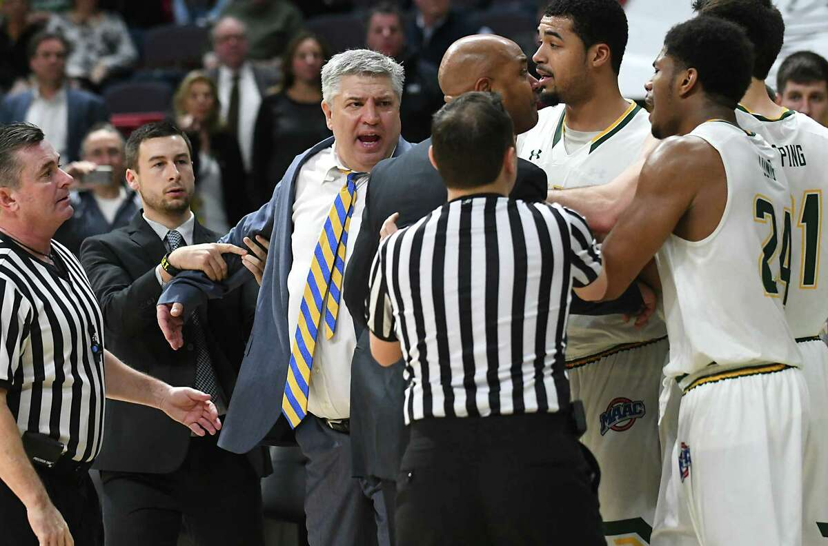 Referees and coaches try to hold back head coaches Jimmy Patsos of Siena, center, and Kevin Baggett of Rider, right of center, during a fight that broke out during a basketball game at the Times Union Center on Tuesday, Jan. 17, 2017, in Albany, N.Y. (Lori Van Buren/Times Union archive)