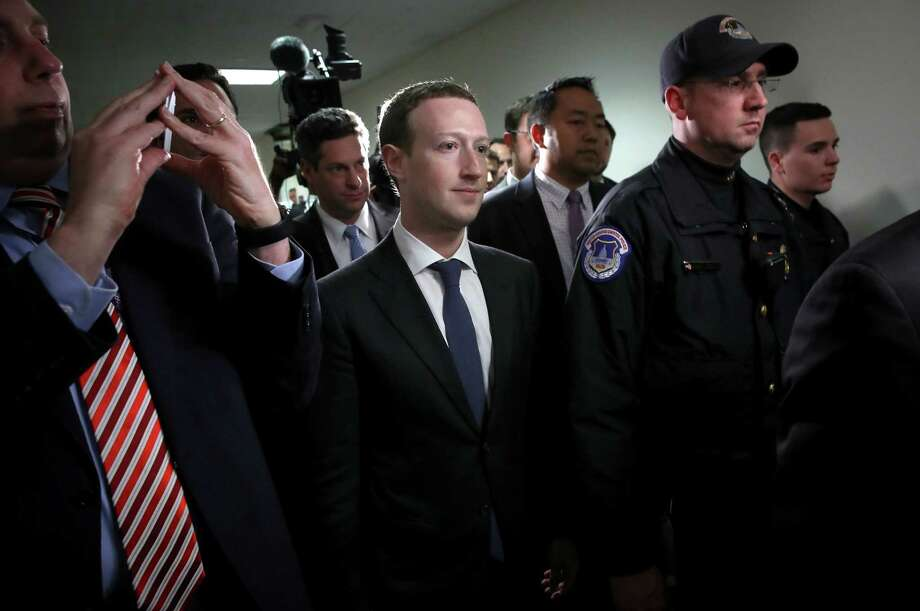 WASHINGTON, DC - APRIL 09:  Facebook CEO Mark Zuckerberg (C) leaves the office of Sen. Dianne Feinstein (D-CA) after meeting with Feinstein on Capitol Hill on April 9, 2018 in Washington, DC. Zuckerberg is meeting with individual senators in advance of tomorrow's scheduled hearing before the Senate Judiciary and Commerce committeees. Zuckerberg is under pressure to explain why tens of millions of Facebook user's private information was shared with Cambridge Analytica. (Photo by Win McNamee/Getty Images) Photo: Win McNamee / 2018 Getty Images