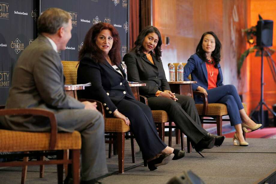 San Francisco Mayoral candidates Angela Alioto, center left, London Breed, center right, and Jane Kim, far right, listen to moderator and Chronicle Editorial Page Editor John Diaz, left, during a Town Hall-style mayoral debate at the San Francisco City Club on April 9, 2018. Photo: Carlos Avila Gonzalez / The Chronicle