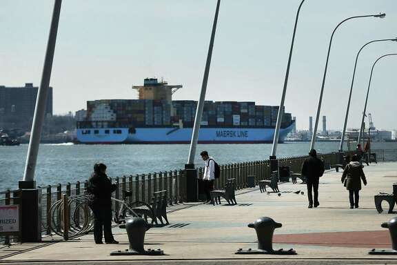 A cargo ship owned by Maersk arrives into New York harbor on Monday.