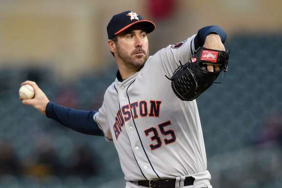 MINNEAPOLIS, MN - APRIL 9: Justin Verlander #35 of the Houston Astros delivers a pitch against the Minnesota Twins during the first inning of the game on April 9, 2018 at Target Field in Minneapolis, Minnesota.