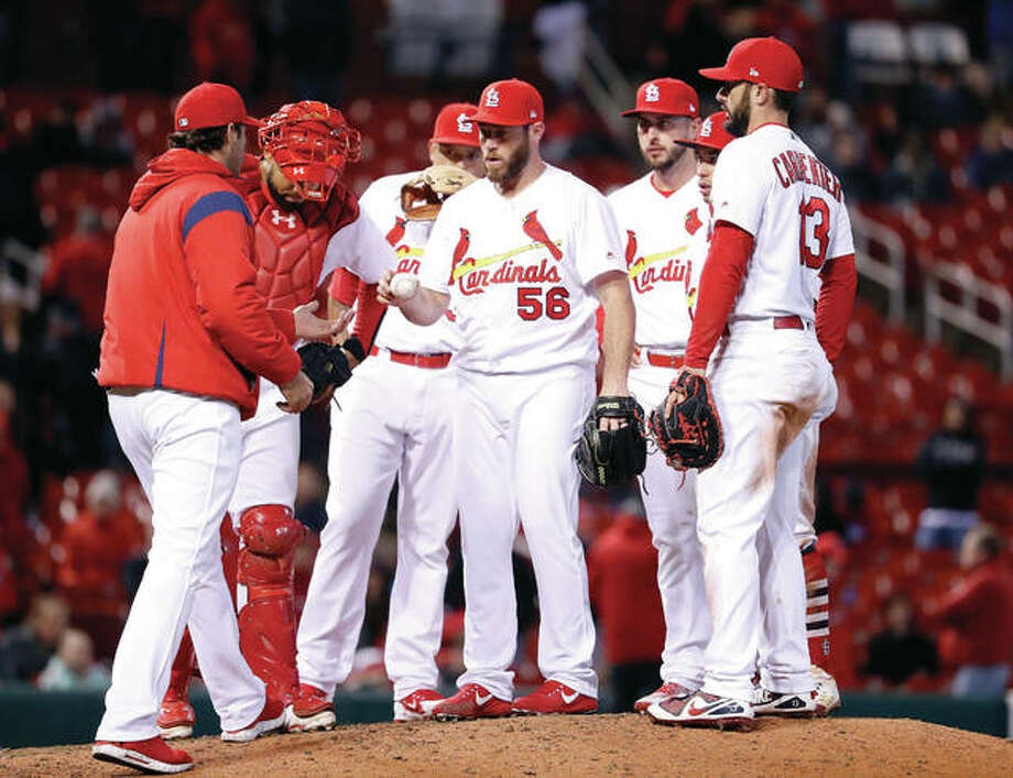 New Cardinals relief pitcher Greg Holland (56) is removed by manager Mike Matheny, left, during the 10th inning of a Monday night's game against the Milwaukee Brewers. The Cardinals lost 5-4 in 10 innings. Photo: AP
