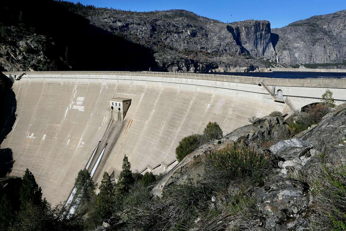 O' Shaughnessy Dam at Hetch Hetchy Reservoir which is currently at fifty percent of capacity, near Groveland, Calif. on Wednesday March 12, 2014, is currently at fifty percent of capacity. San Francisco and the thousands of suburban customers its water agency serves are in a pretty good spot currently as it relates to the drought, but water officials want to plan ahead. So the San Francisco Public Utilities Commission is looking into the possibility of diverting water into the Lower Cherry Aqueduct and eventually into the Hetch Hetchy water supply.