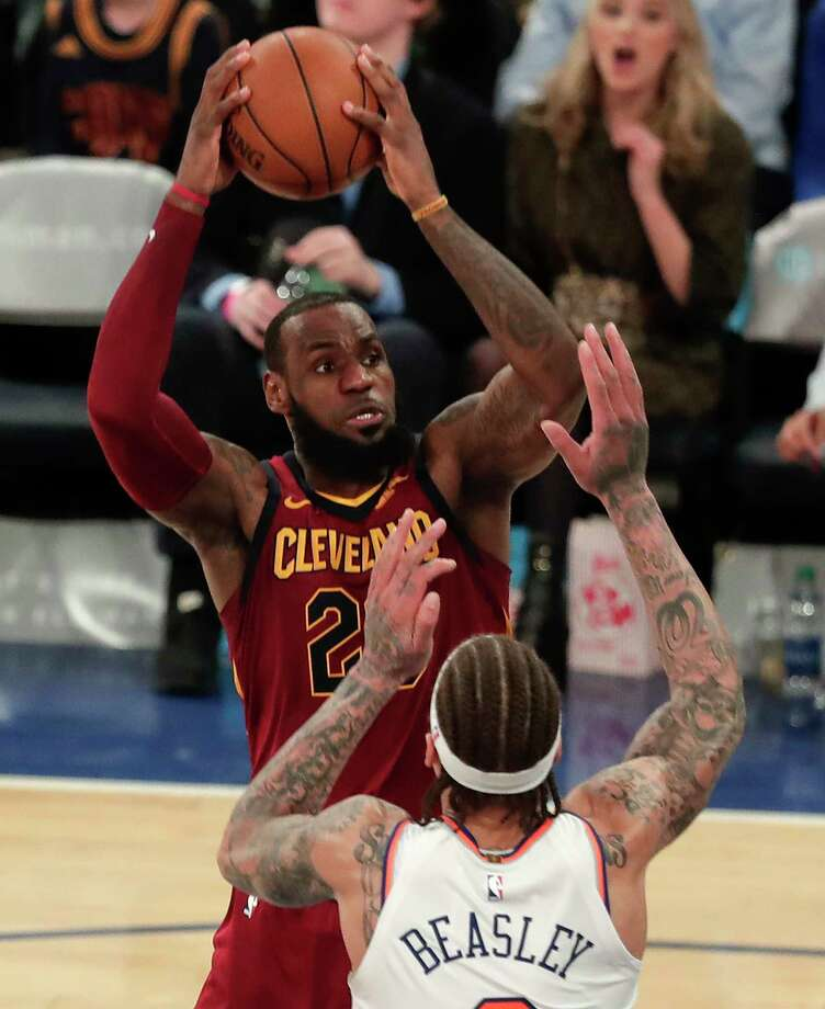 Cleveland Cavaliers forward LeBron James, top, looks to shoot against New York Knicks forward Michael Beasley, bottom, during the third quarter of an NBA basketball game, Monday, April 9, 2018, in New York. (AP Photo/Julie Jacobson) Photo: Julie Jacobson / Copyright 2018 The Associated Press. All rights reserved.