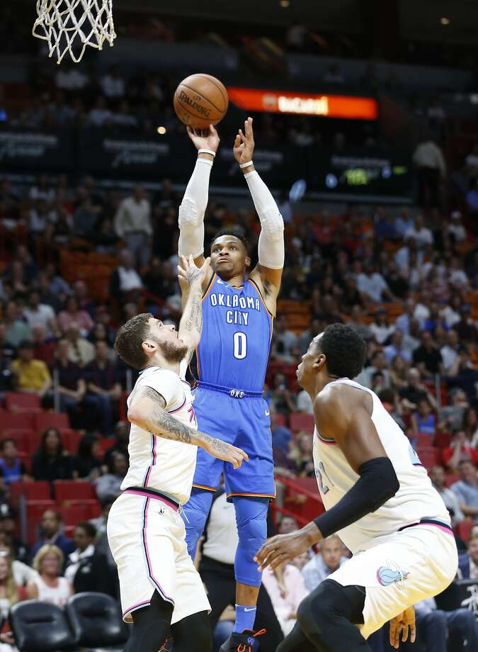 Oklahoma City Thunder guard Russell Westbrook (0) shoots against Miami Heat guard Tyler Johnson, left, and center Hassan Whiteside (21) during the first half of an NBA basketball game, Monday, April 9, 2018, in Miami. (AP Photo/Wilfredo Lee) Photo: Wilfredo Lee / Associated Press