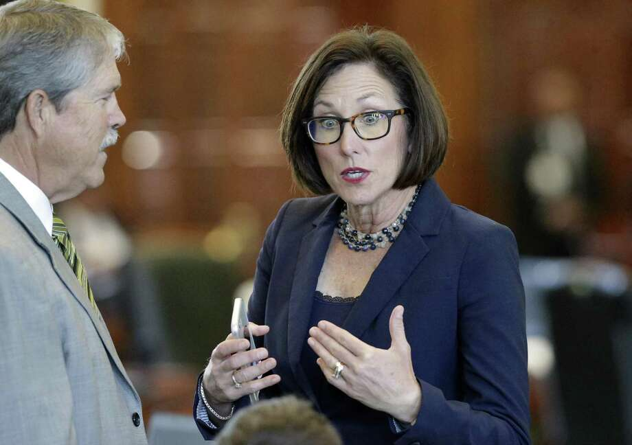"""Sen. Lois Kolkhorst, R-Brenham, argues a point on the floor with Sen. Larry Taylor, R-Friendswood, during the the special session on July 26. Kolkhorst, who authored 2017 legislation to extend a task force investigating maternal mortality, used the new study to praise the Legislature's approach to the issue. """"It is clear that Texas does not have the worst maternal mortality in the developed world and that previous reports were grossly inaccurate,"""" says Kolkhorst. """"We as a state can and are doing more to improve maternal health outcomes."""" Photo: Tom Reel /San Antonio Express-News / 2017 SAN ANTONIO EXPRESS-NEWS"""