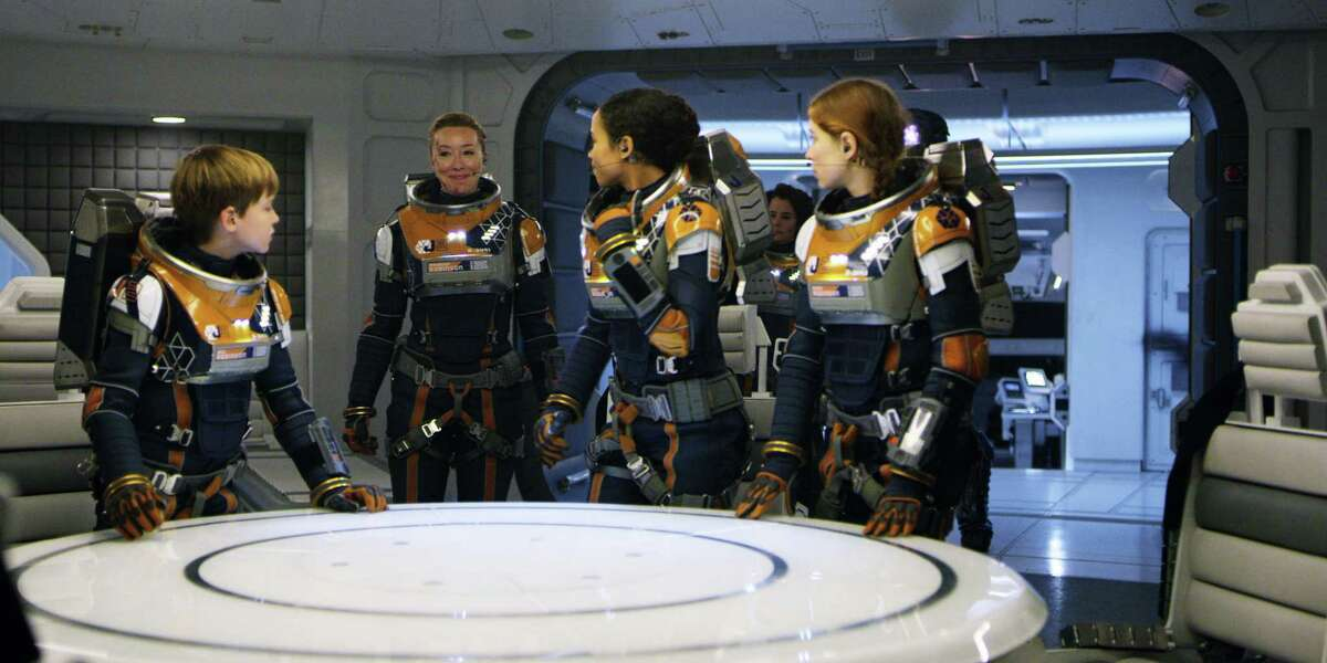 """""""Lost in Space"""" actors Max Jenkins (left), Molly Parker, Taylor Russell, Parker Posey and Mina Sundwall."""
