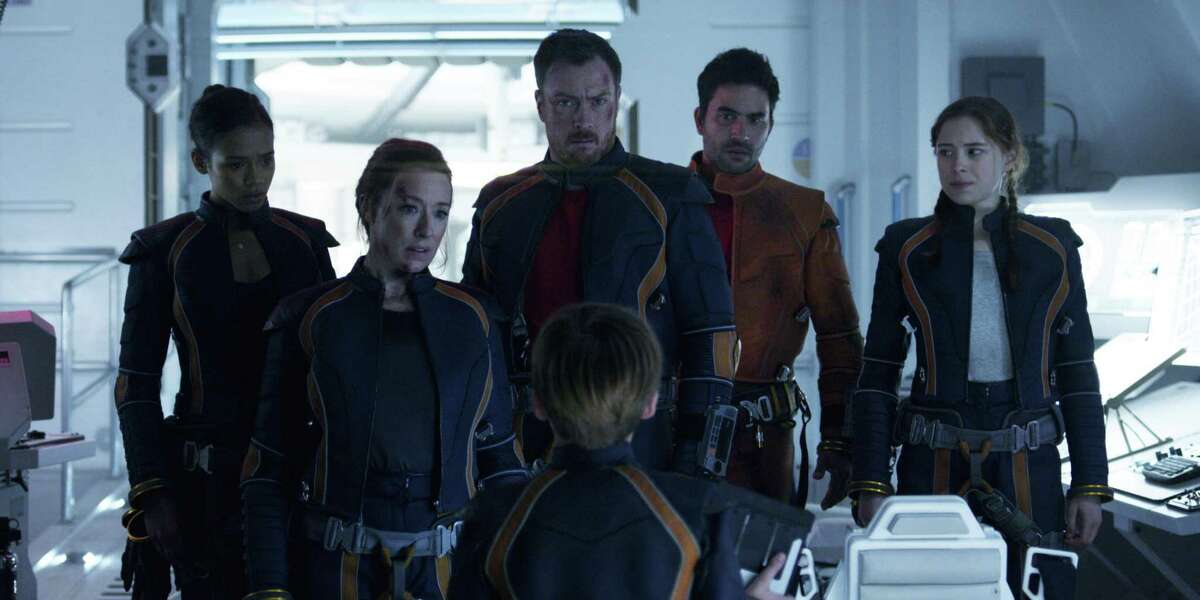 """""""Lost in Space"""" cast members Taylor Russell (left), Molly Parker, Toby Stephens, Max Jenkins, Ignacio Serricchio and Mina Sundwall."""