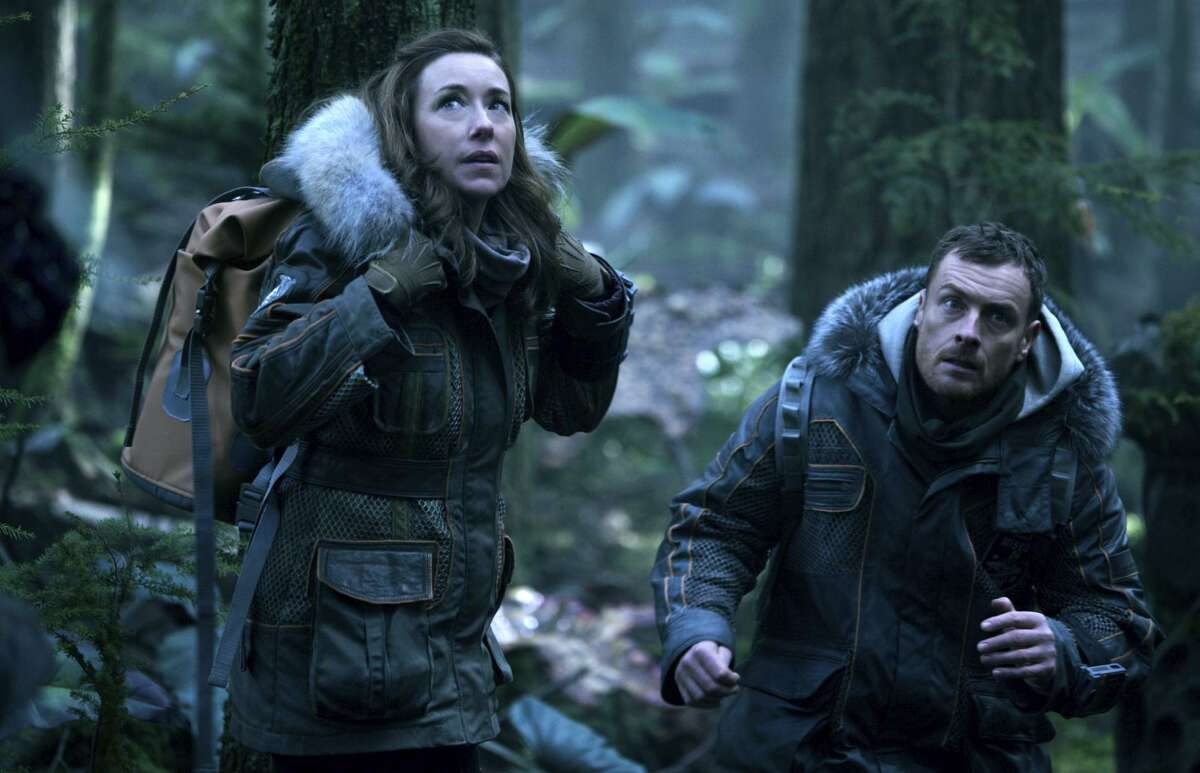 """Molly Parker and Toby Stephens star as the Robinson parents in a somewhat plodding remake of the TV series """"Lost in Space."""""""