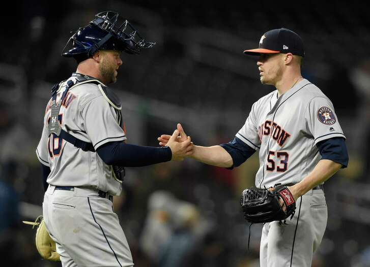 MINNEAPOLIS, MN - APRIL 9: Brian McCann #16 and Ken Giles #53 of the Houston Astros celebrate winning against the Minnesota Twins after the game on April 9, 2018 at Target Field in Minneapolis, Minnesota. The Astros defeated the Twins 2-0.
