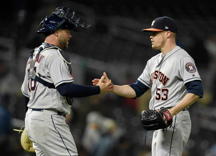 Astros reliever Ken Giles, right, got his first save of the season, but it didn't come without a scare. Photo: Hannah Foslien, Getty Images / 2018 Getty Images