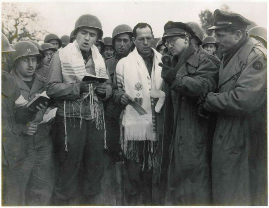 Max Fuchs (left, in prayer shawl) sings in Aachen, Germany, in 1944, during the first Jewish religious service held in the country since Adolf Hitler's rise to power in the 1930s. Photo: Courtesy Max Fuchs 1944