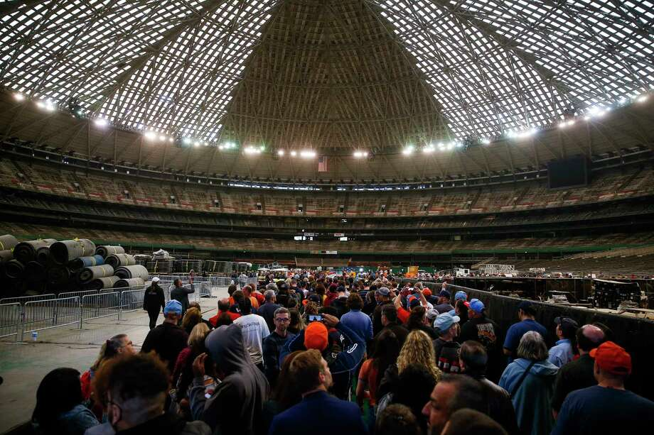 People take photos as they enter the Astrodome during Domecoming, an event celebrating the 53rd anniversary of the stadium, Monday, April 9, 2018 in Houston.