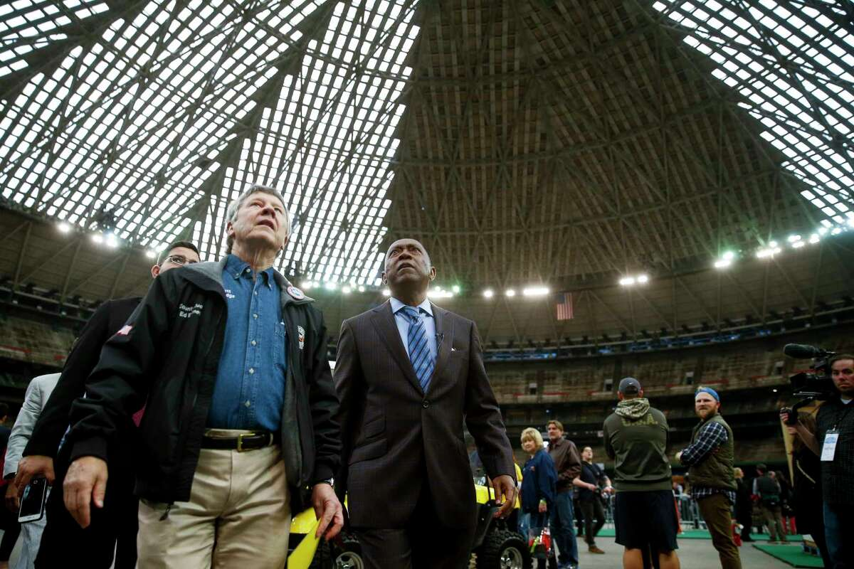 Harris County judge Ed Emmett, left, and Houston mayor Sylvester Turner take in the scenery during Domecoming, an event celebrating the 53rd anniversary of the Astrodome, Monday, April 9, 2018 in Houston.