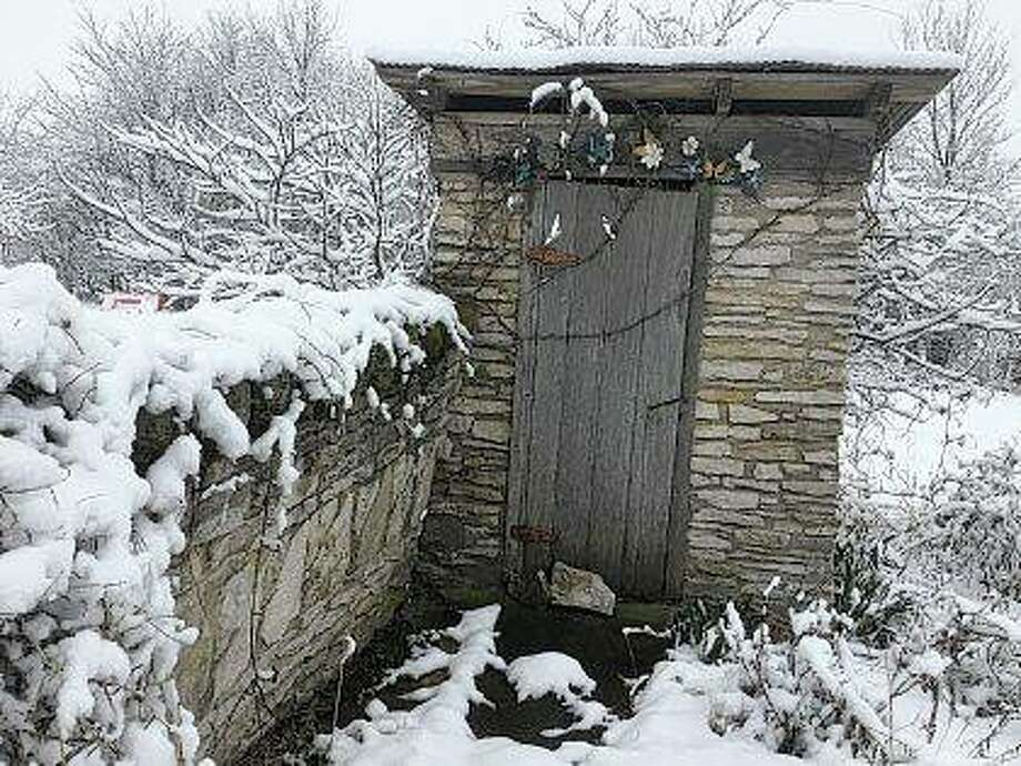 A long-unused stone outhouse sits at the end of a chilly path. Photo: Vonna Park | Reader Photo