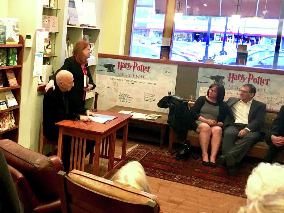 Susan Novotny, owner of The Book House of Stuyvesant Plaza in Guilderland, introduces Peter Golden before his book reading Monday night.