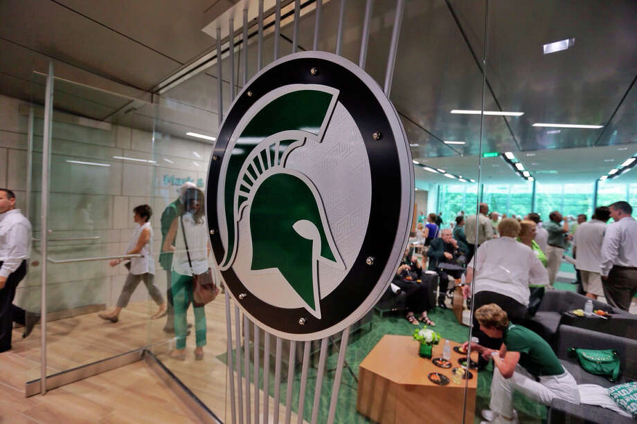 FILE - In this Aug. 25, 2014, file photo, people tour the new North End Zone Complex renovations at Spartan Stadium on the Michigan State Campus in East Lansing, Mich. A woman who attends Michigan State University filed a federal lawsuit against the school Monday, April 9, 2018, alleging that three former men's basketball players sexually assaulted her at an off-campus apartment in 2015 and that she was discouraged from reporting what happened. (Ryan Garza/Detroit Free Press via AP, File) Photo: Ryan Garza/Associated Press
