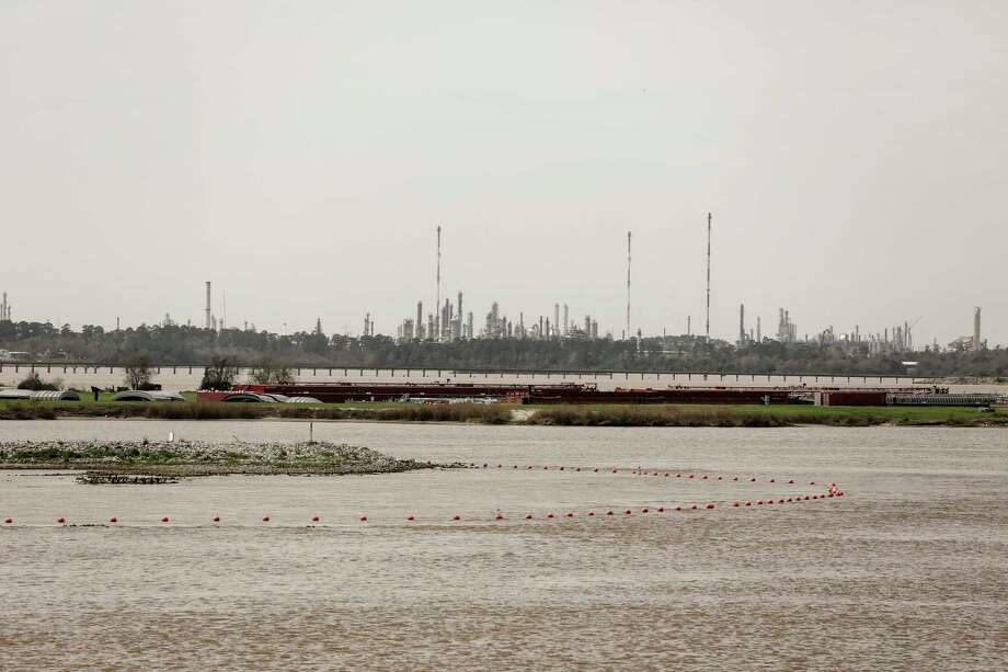 Orange buoys mark the waste pits that have ended up under water that are contaminated by dioxins from a paper mill, photographed on  Thursday, March 1, 2018, in Highlands. Photo: Elizabeth Conley, Houston Chronicle / © 2018 Houston Chronicle