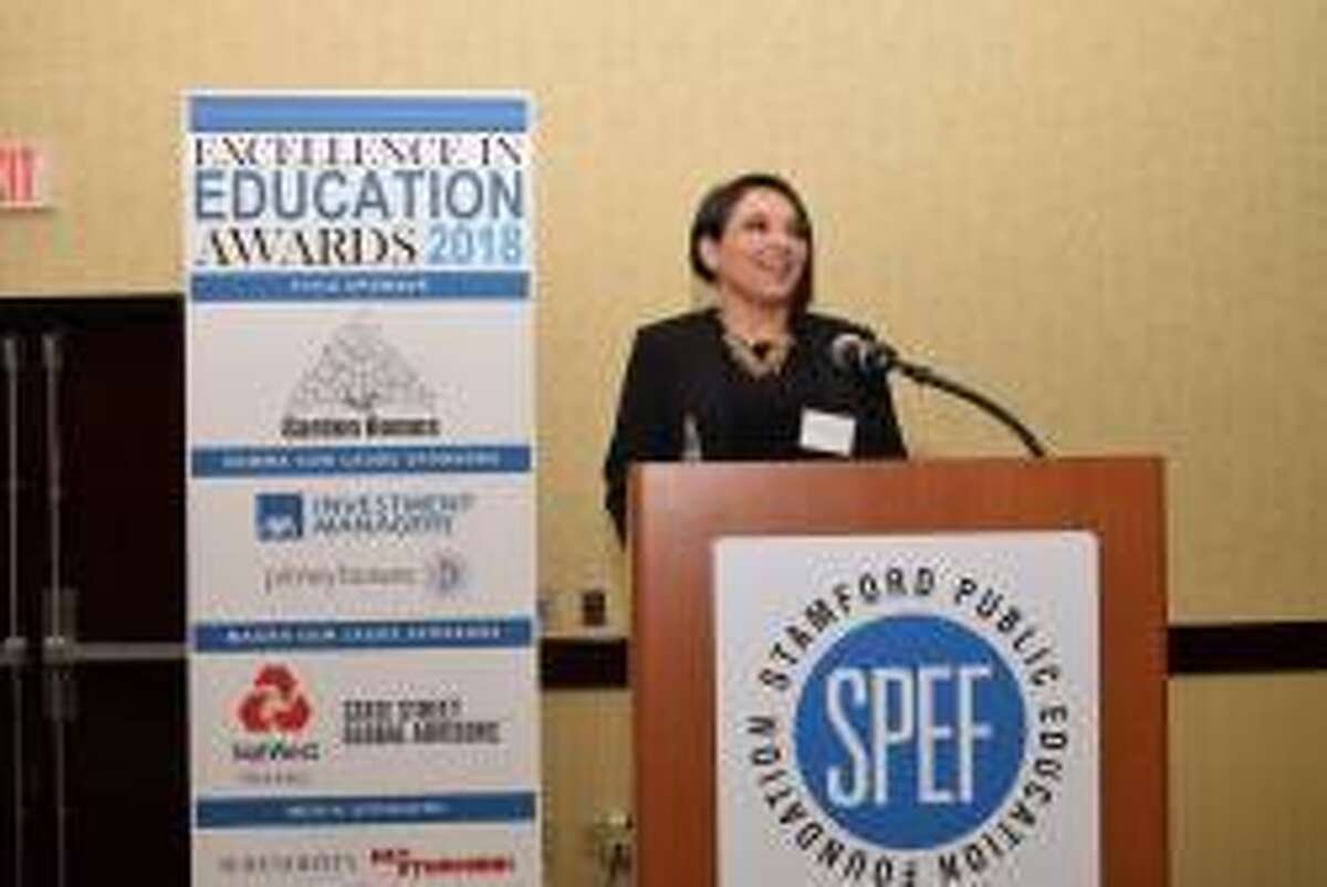 Ellie Kousidis, a library media specialist at Rippowarm Middle School, accepts the 2018 Stamford Public Education Foundation award at the Excellence in Education Awards Celebration in Stamford, Conn. on March 22, 2018.