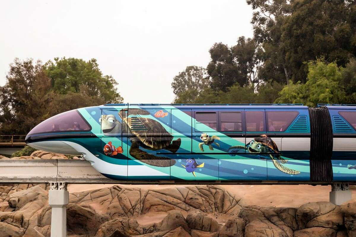 And, the monorail that travels between the two parks will be wrapped with images of characters from Pixar films.