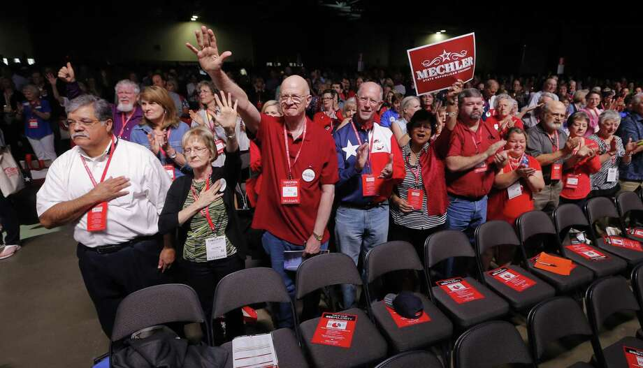 Delegates clap after the National Anthem at the Republican Party of Texas state convention in Dallas in 2016. The state party's executive committee once again is refusing to allow the Log Cabin Republicans, who promote a message of LGBT includsion, a booth at the convention this year. Photo: Rodger Mallison /TNS / Fort Worth Star-Telegram