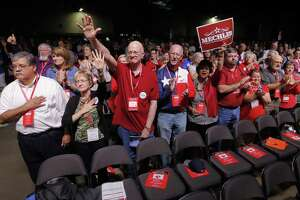 Delegates clap after the National Anthem at the Republican Party of Texas state convention in Dallas in 2016. The state party's executive committee once again is refusing to allow the Log Cabin Republicans, who promote a message of LGBT includsion, a booth at the convention this year.