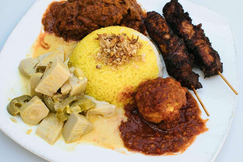Nasi padang, which includes rice, kale, tempeh balado, jackfruit curry, satay and corn fritter at Indo Cafe in Saratoga. Photo: Mason Trinca / Special To The Chronicle
