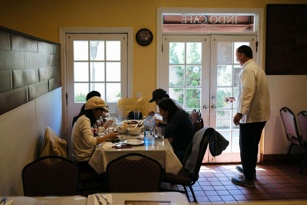 Patrons enjoy lunch at the Indo Cafe in Saratoga, Calif. Sunday, April 8, 2018.