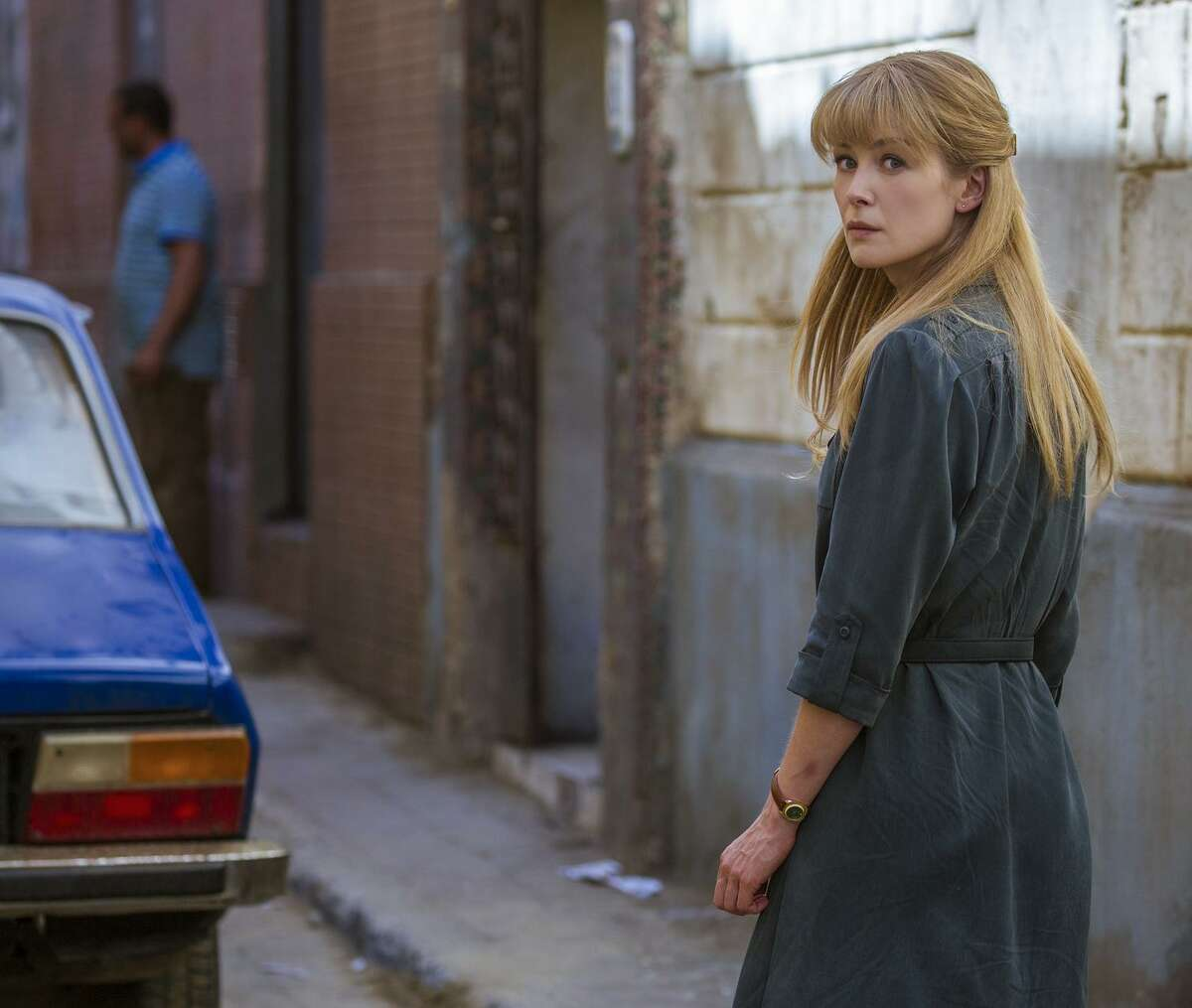 """Jon Hamm, top, and Rosamund Pike, right, star in """"Beirut,"""" a thriller written by Tony Gilroy and directed by Brad Anderson."""