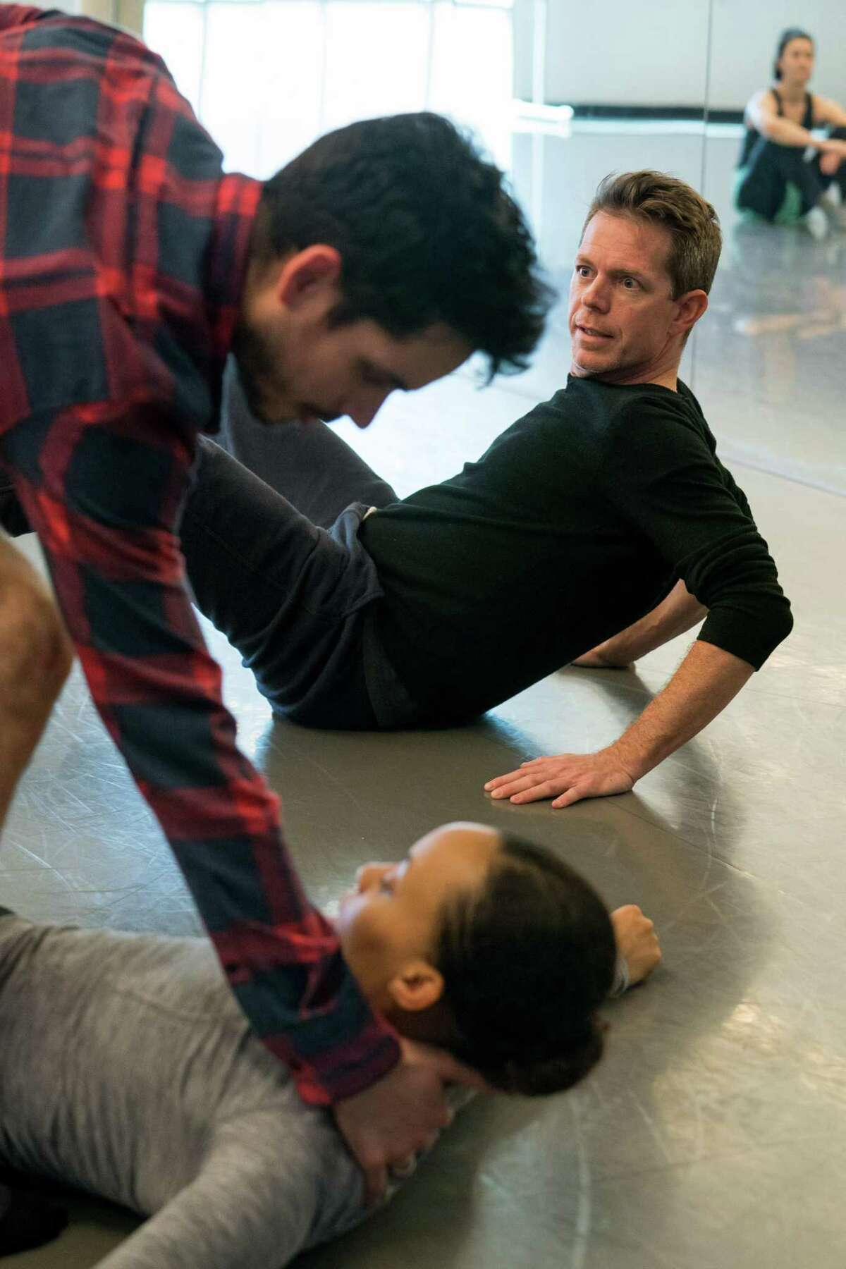 Choreographer Dominic Walsh rehearses with artists of MetDance in the company's Midtown studios, preparing for the premiere of a new 30-minute work that debuts April 13-14 at Hobby Center.