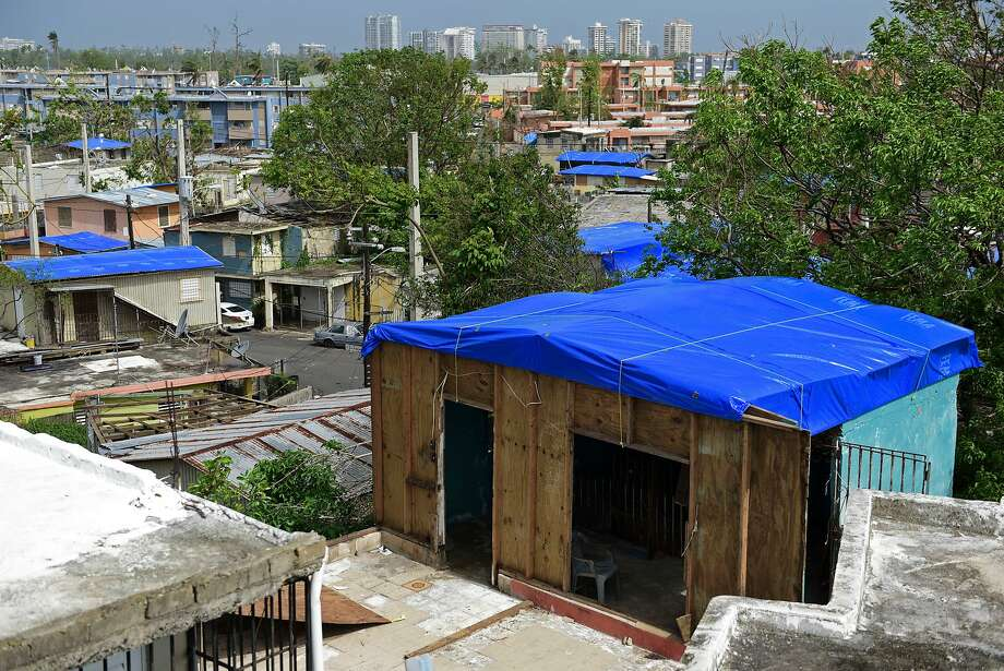 Damaged homes are covered with FEMA tarps in the Cantera area of San Juan, Puerto Rico. Photo: Carlos Giusti / Associated Press 2017