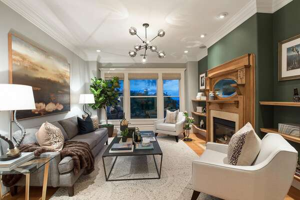 The parlor at  240 Downey St. in Cole Valley offers three tall, dual hung picture windows framing neighborhood views.�