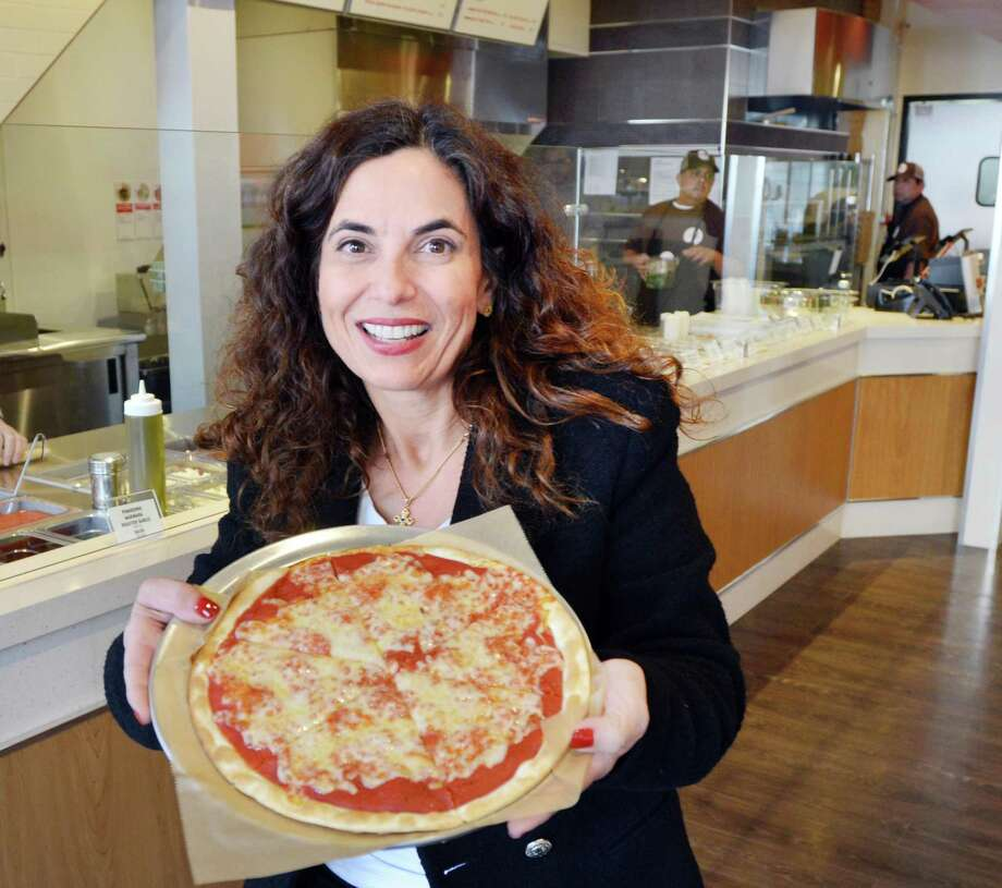 Eleni Bouboulis, the franchise owner of the new Skinny Pizza restaurant, holding a Skinny Pizza inside the company's first Connecticut location at 30 Greenwich Avenue, Greenwich, Conn., Thursday, April 5, 2018. Skinny Pizza is a New York City-based franchisor and the Greenwich restaurant will officially open on Wednesday, April 11th. The menu also includes salads, soups and pastas. Photo: Bob Luckey Jr. / Hearst Connecticut Media / Greenwich Time